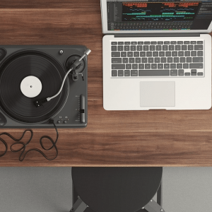 A set of DJ decks, connected to a laptop, ready to create music