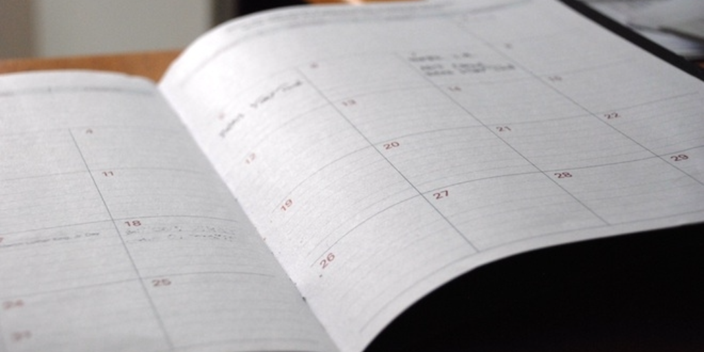 A paper schedule, in diary form in a book