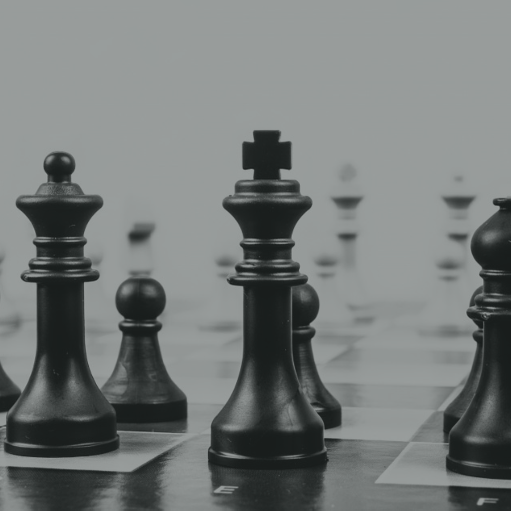 Chess pieces on a board, taken from the level of the board - an informed decision