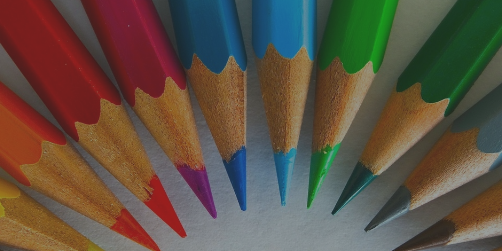 A group of pencils of various colours, all focused on one spot