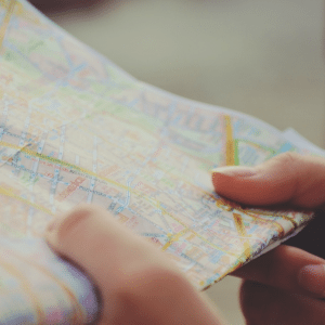 A person holding a map in their hands, representing a search for procrastination