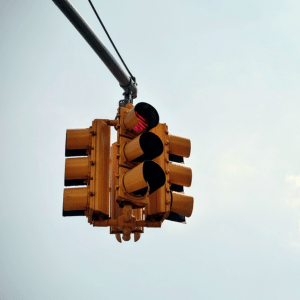 A stop sign with a red light, representing procrastination being stopped