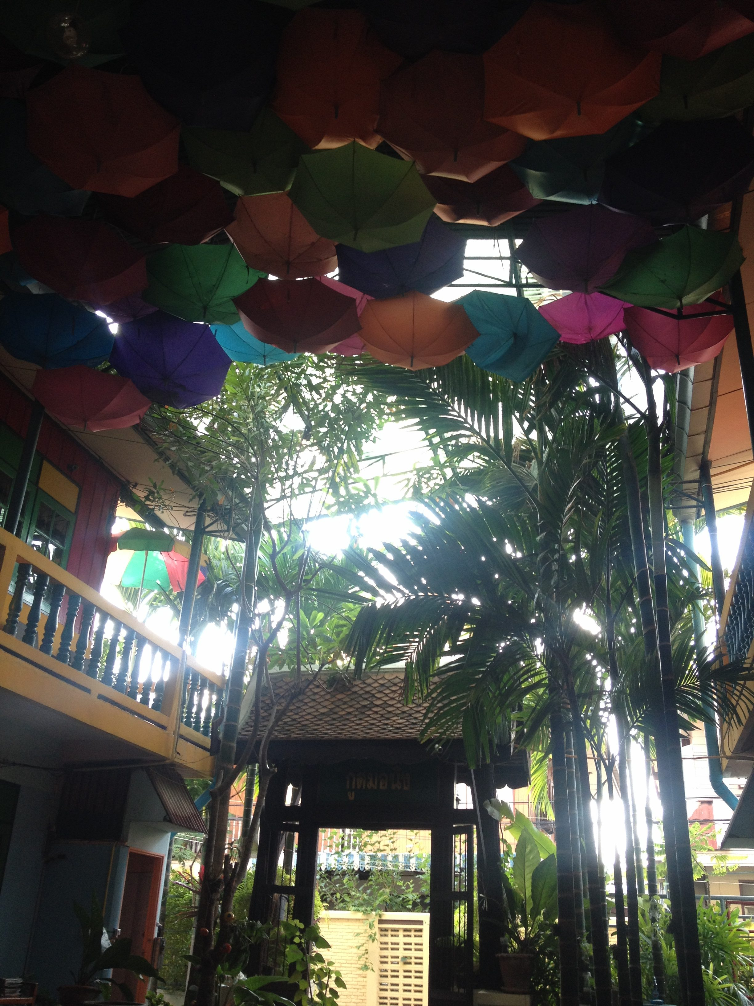 Umbrellas on the ceiling at the Goodmorning by Tamarind Hostel in Ayutthya, Thailand