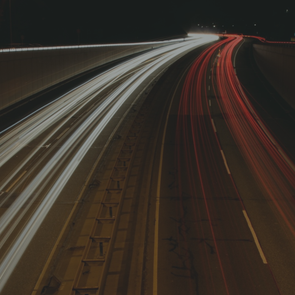 A time lapse photo of a road, showing the cars as blurs