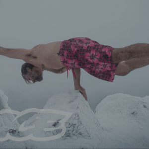 Climbing a mountain nearly naked — Wim Hof on a mountain wearing only shorts and shoes
