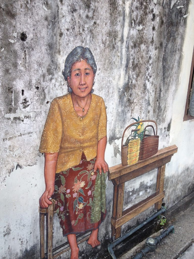 Graffiti of an old woman from Phuket old town