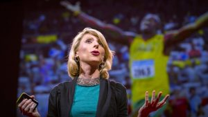 Amy Cuddy presenting her TED talk on how your body language may shape who you are