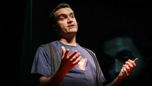Carl Honoré presenting his TED talk praising slowness