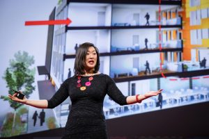Grace Kim presenting her TED talk on how cohousing can make us happier