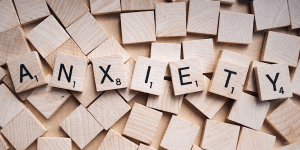 Scrabble pieces spelling out the word 'anxiety'