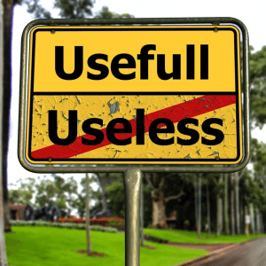 A roadsign with the place names 'Usefull' and 'Useless' on it, representing effectiveness and ineffectiveness