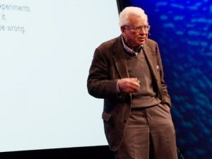 Murray Gell-Mann presenting his TED talk on the ancestor of language