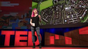 Karoliina Korppoo presenting her TED talk on how the video game Cities: Skylines could be used to design better cities